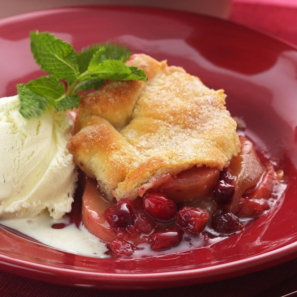 Cranberries add a particularly pleasing tartness and color to pears. Fresh ginger, lemon and vanilla brighten up the pears, while reduced-fat sour cream adds flavor to the biscuit-dough crust. Recipe by Nancy Baggett for EatingWell.