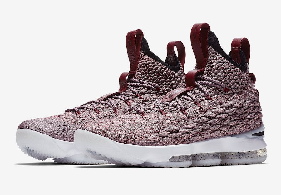 9a41f7225a2 This new colorway of the Nike LeBron 15 features a light red BattleKnit  upper with dark