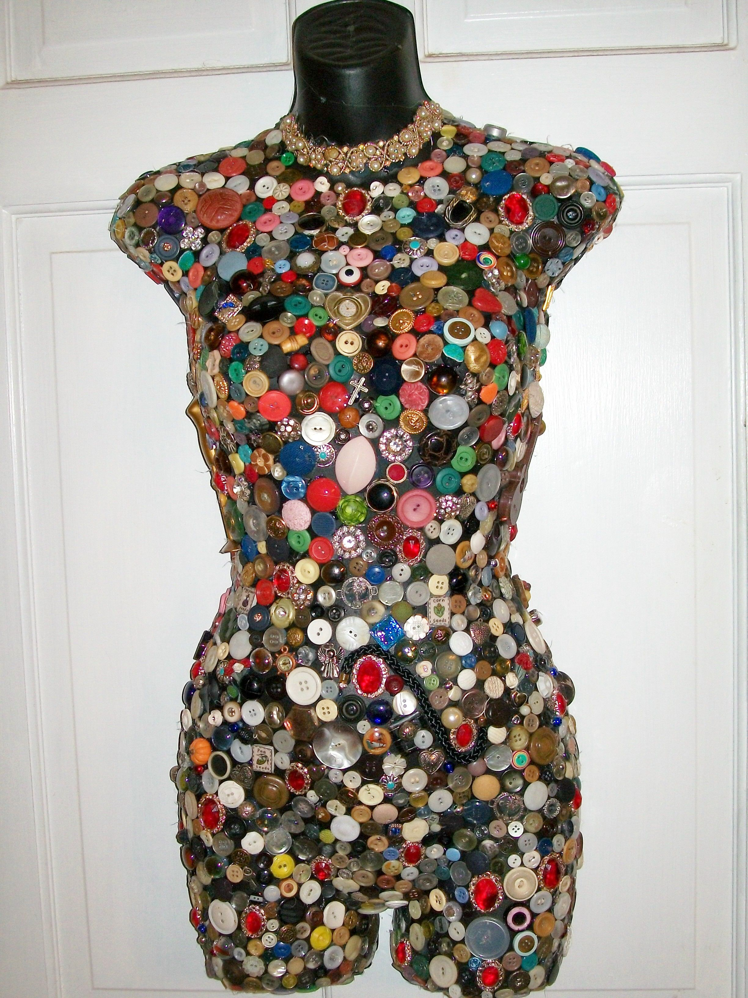 Mannequin Body covered in buttons jewelry and interesting little
