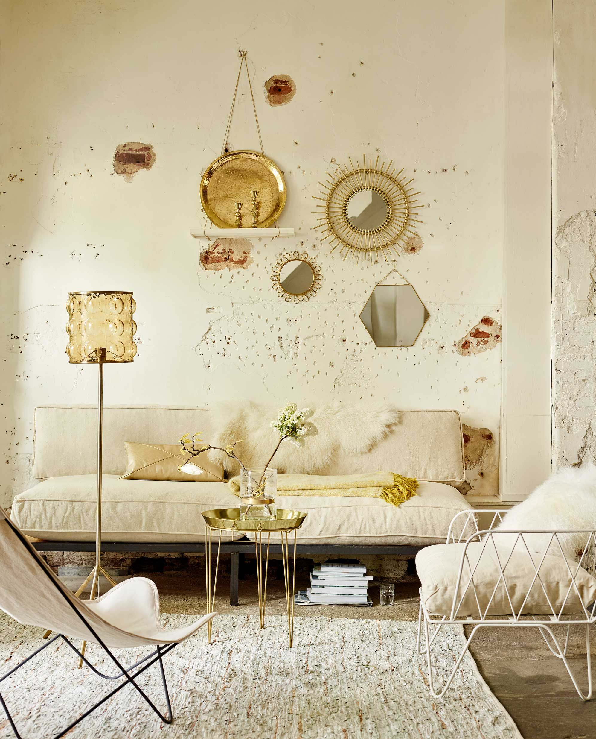 Creamy white living room with golden details and raw walls | Life ...