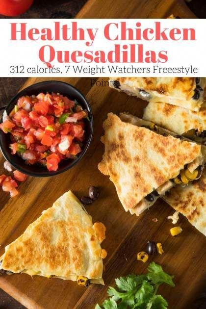 These Healthy Chicken Quesadillas come together in less than twenty minutes and are filled with good for you ingredients like chicken, beans, corn, and tomatoes. With 300 calories and 27 grams of protein, this quesadilla will keep you full all day. | Slender Kitchen | Weight Watchers | Lunch | Dinner | Chicken |