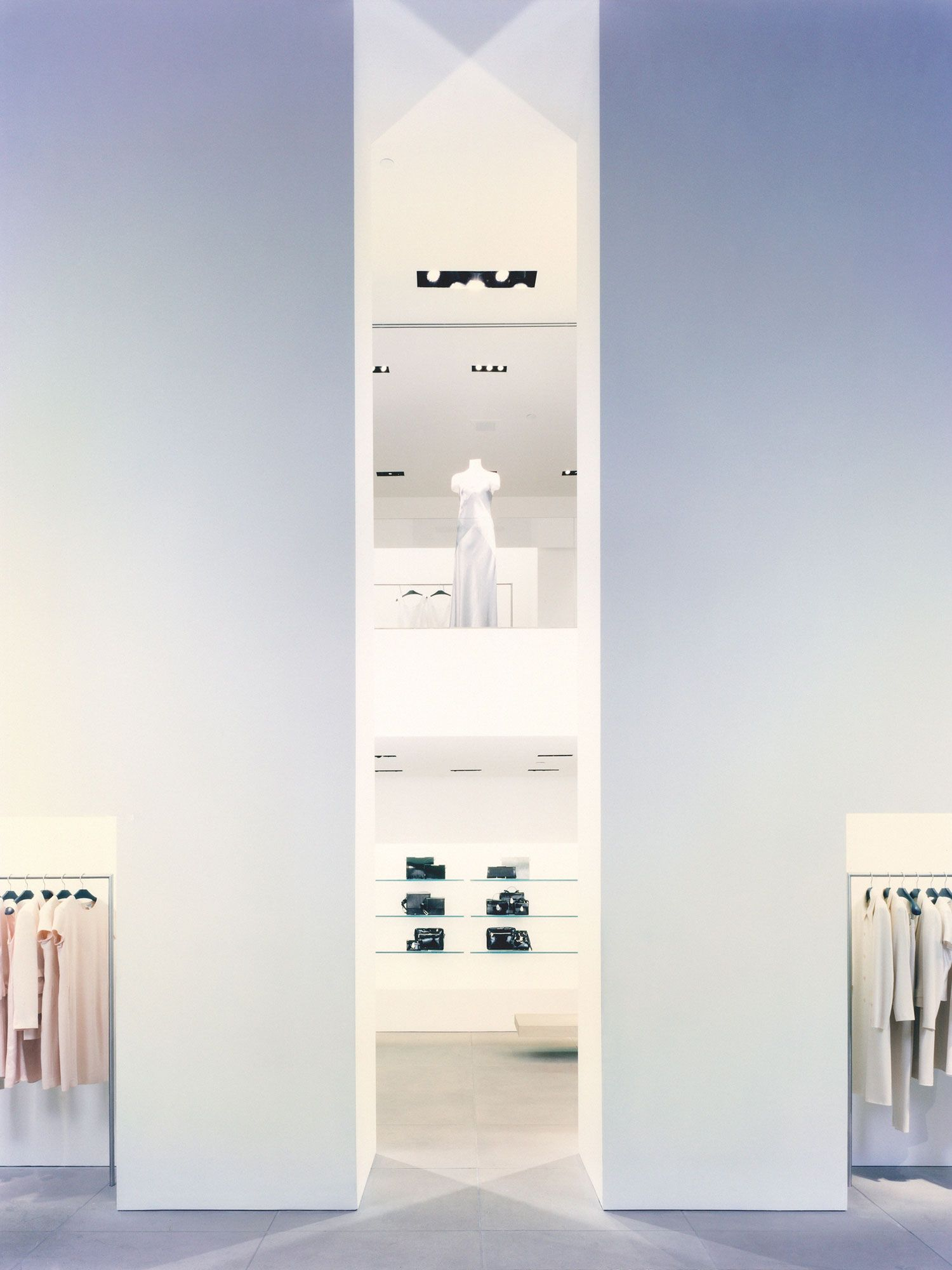 structural columns inside the white calvin klein store in new york by john pawson retail. Black Bedroom Furniture Sets. Home Design Ideas