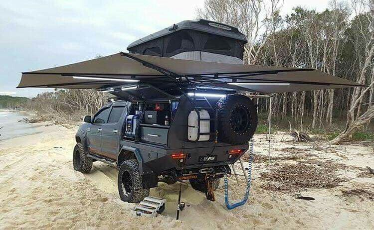 crew cab truck with custom camper cargo section with roof