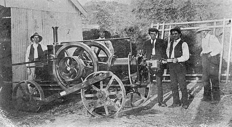 1910. Five men with an 8 hp 'Ronaldson-Tippett' portable farm engine, probably driving a chaff cutter. Wimmera?