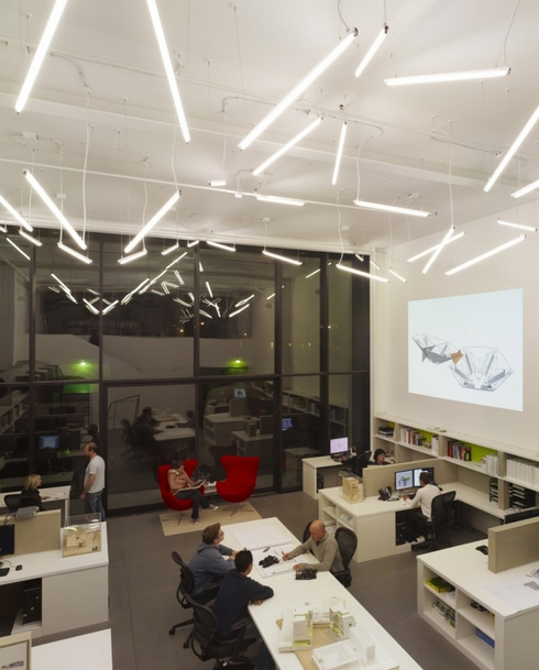Exposed ceiling with scattered florescent lamps Office