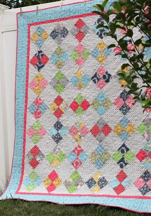 Farmhouse Four Patch Quilt Tutorial | This pretty patchwork quilt shows you how to quilt on the diagonal!