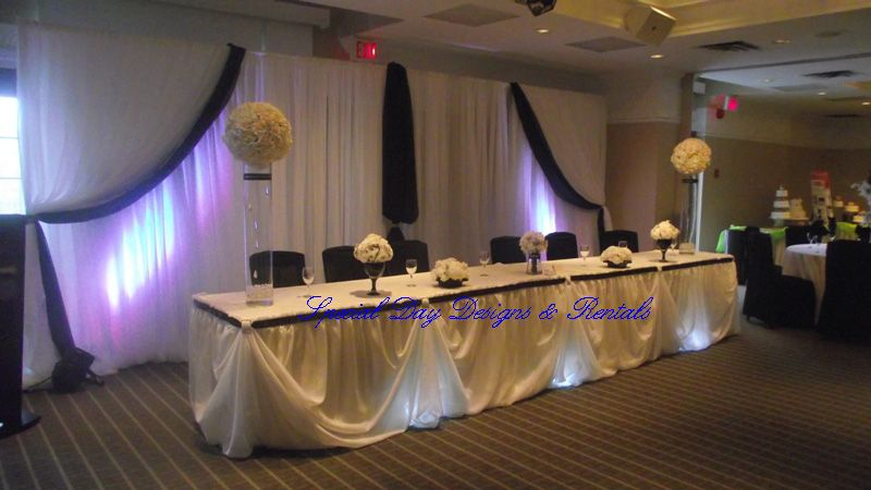 wedding head table decoration ideas black white head table and backdrop with strategic lighting