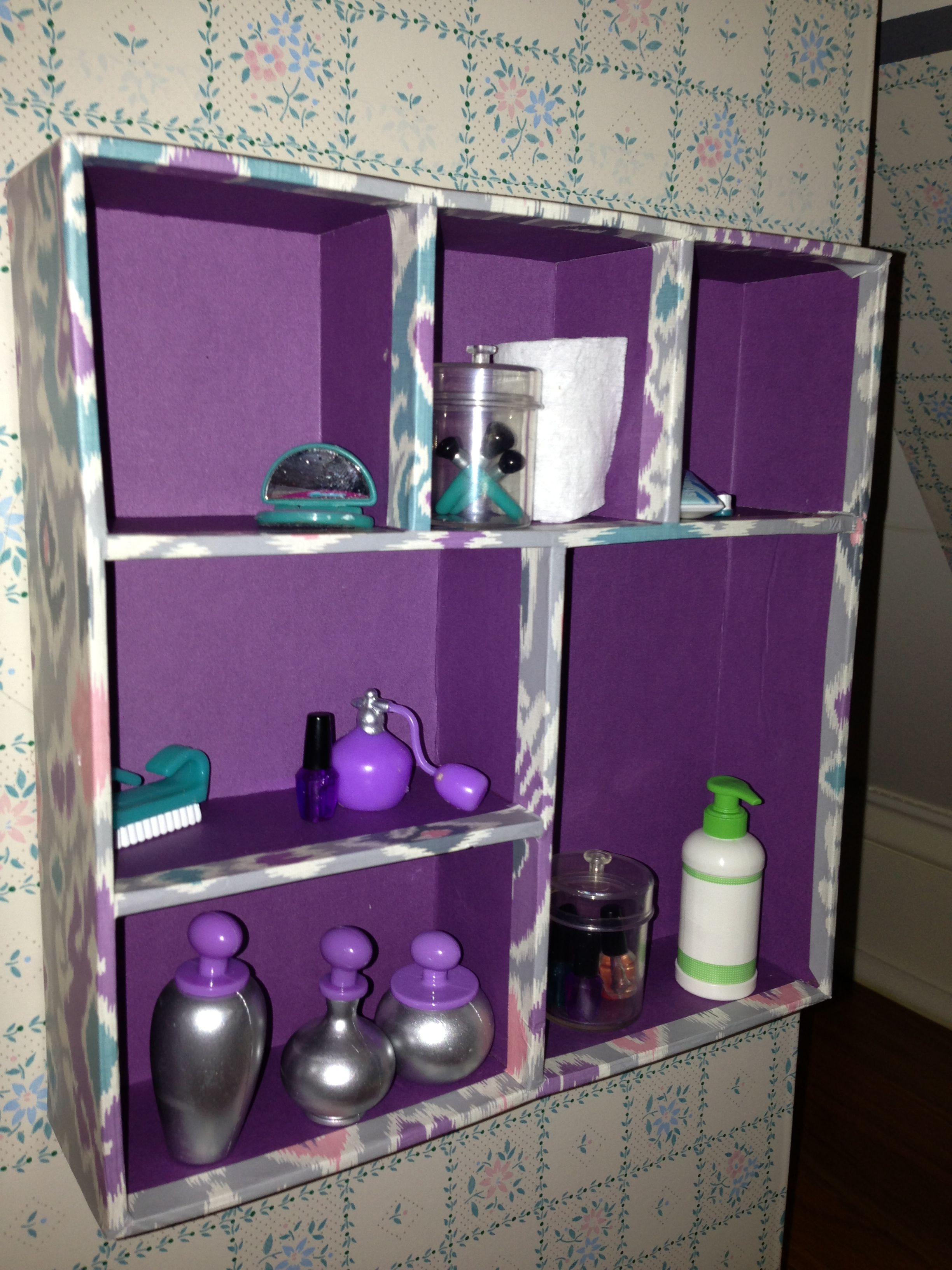 Bathroom cabinet for American Girl doll. Love this idea by the person who pinned this. Would be cute for my daughter.