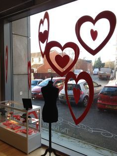 Our Valentines Day window and displays are going up!