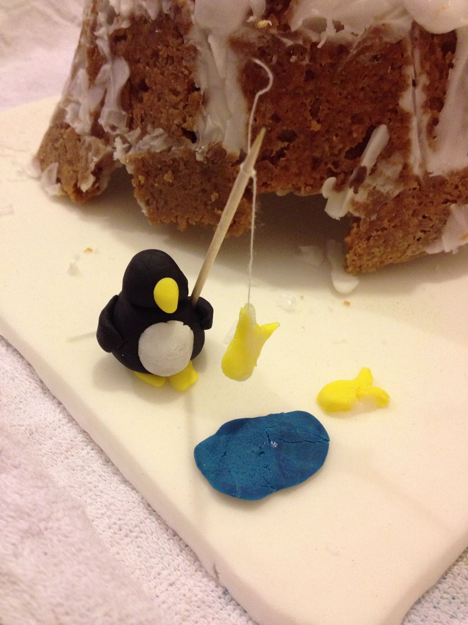 Icing penguin fishing