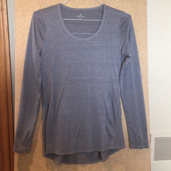 Athleta Shimmer top Long sleeve shimmer top by Athleta. Breathable fabric with unique shimmer detail throughout. Thumb holes, size S. Great condition. Athleta Tops