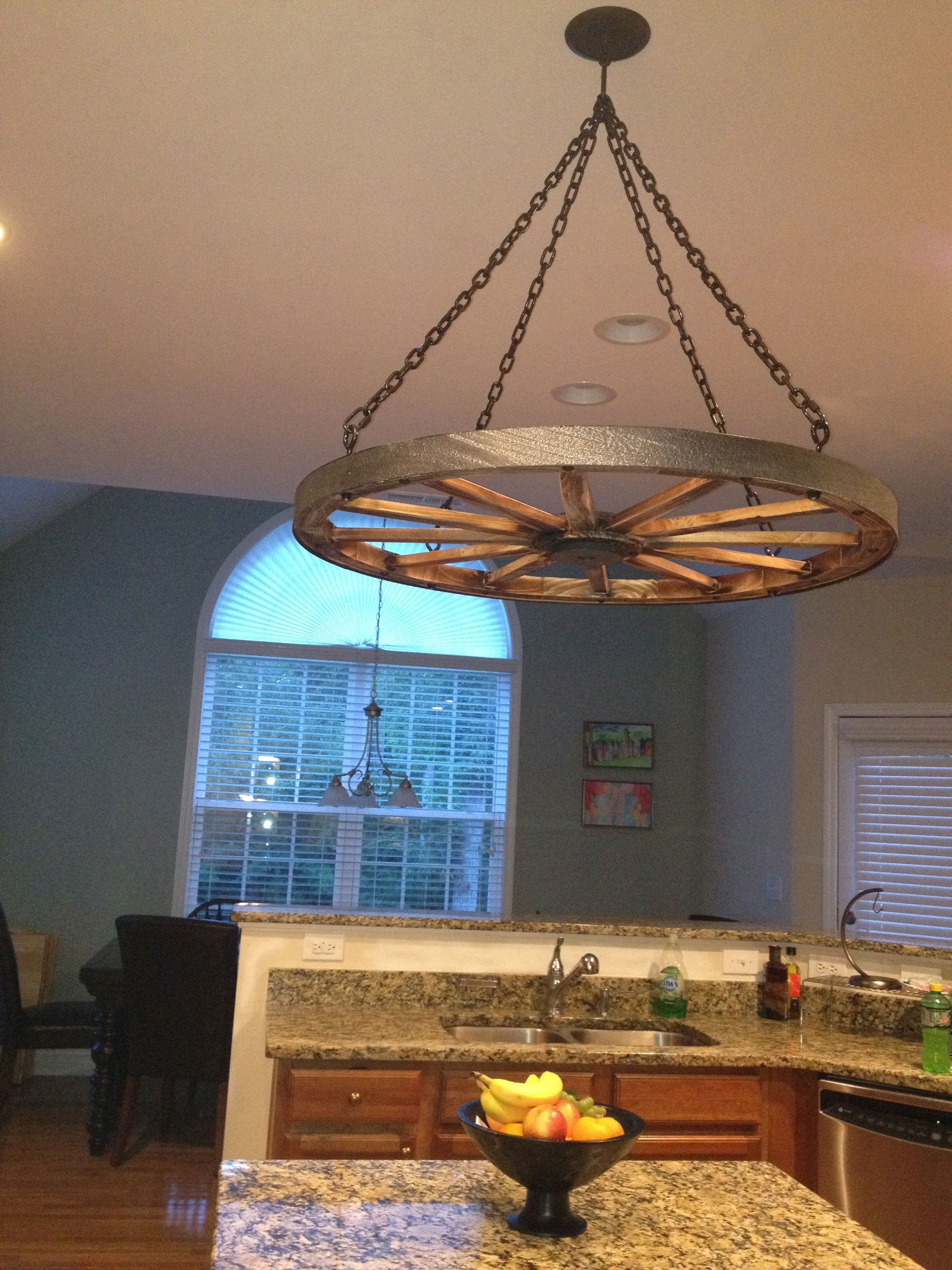 Diy Wagon Wheel Pot Rack Just Need Some S Hooks And It Is