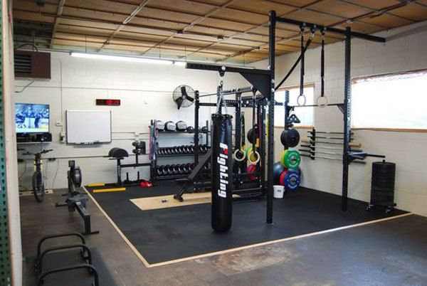 Dedicated garage gym complete with flooring rack ghd