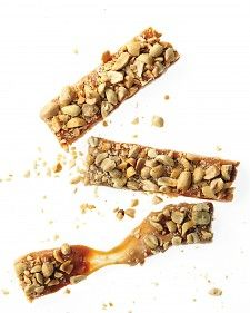 Melted marshmallows give these nutty bars their elastic texture.