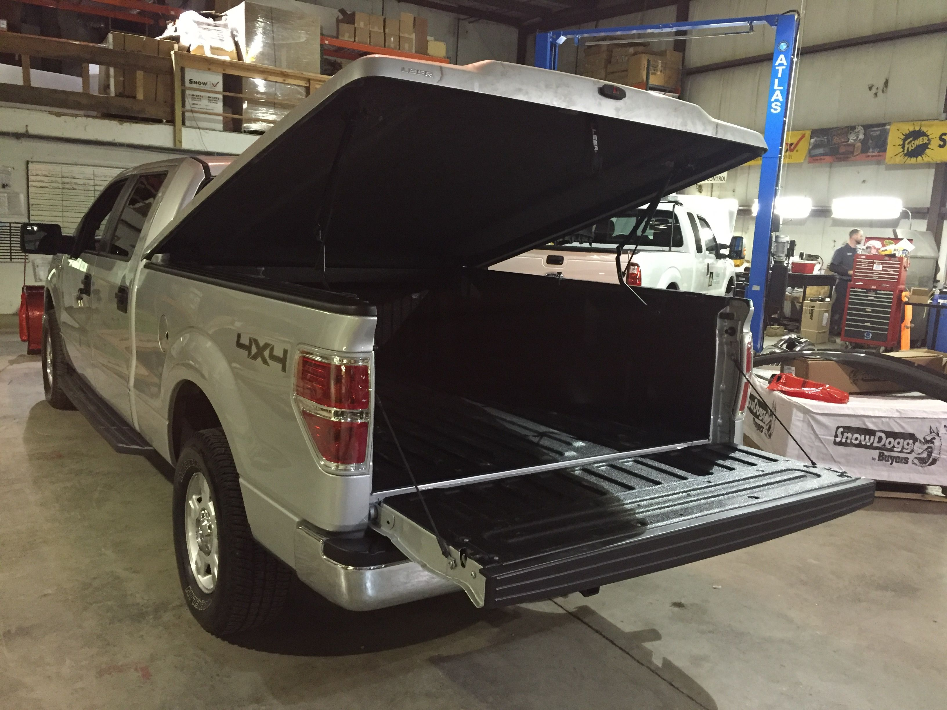 Light Grey 2014 Ford F150 getting installation of Leer 700