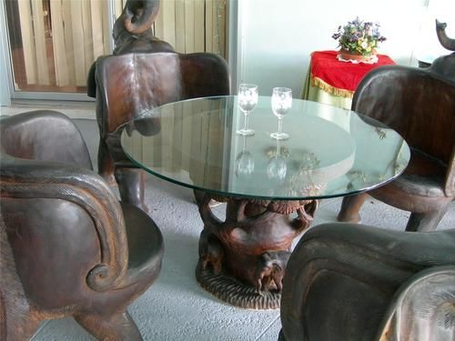 Unique teak wood hand carved elephant chairs and glass top table ...