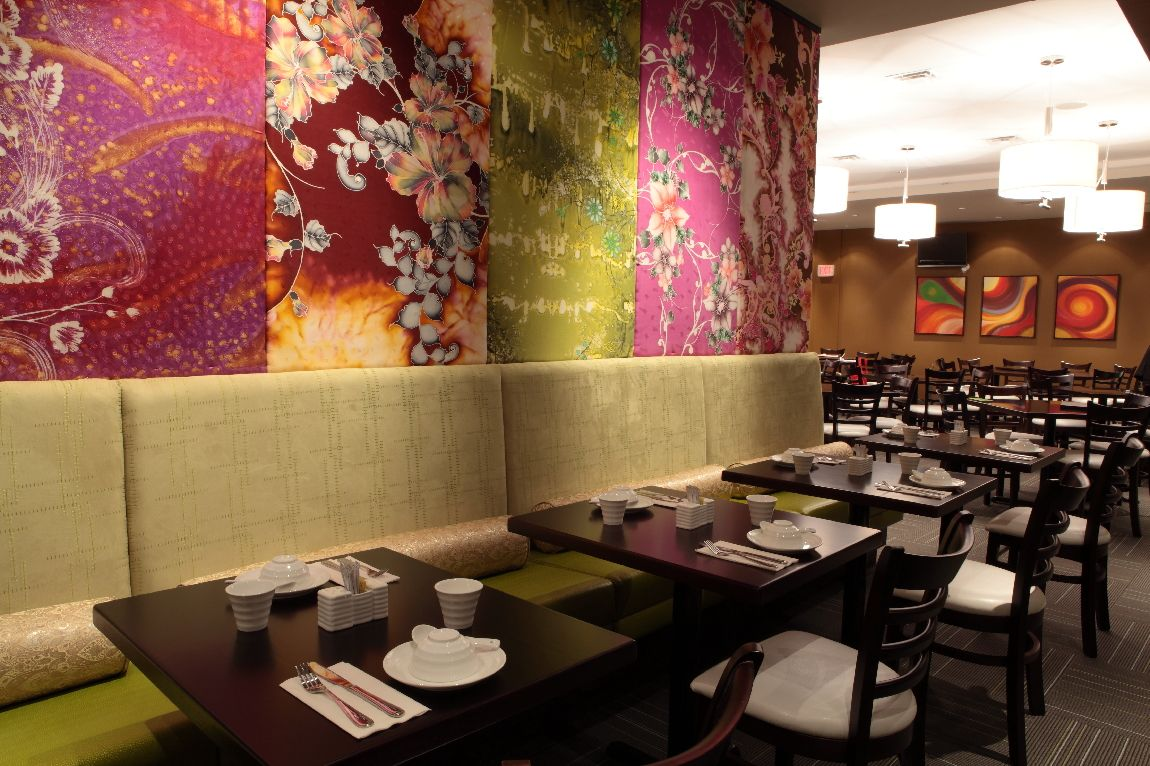 Beautiful fabric panels and bright banquettes sage cafe