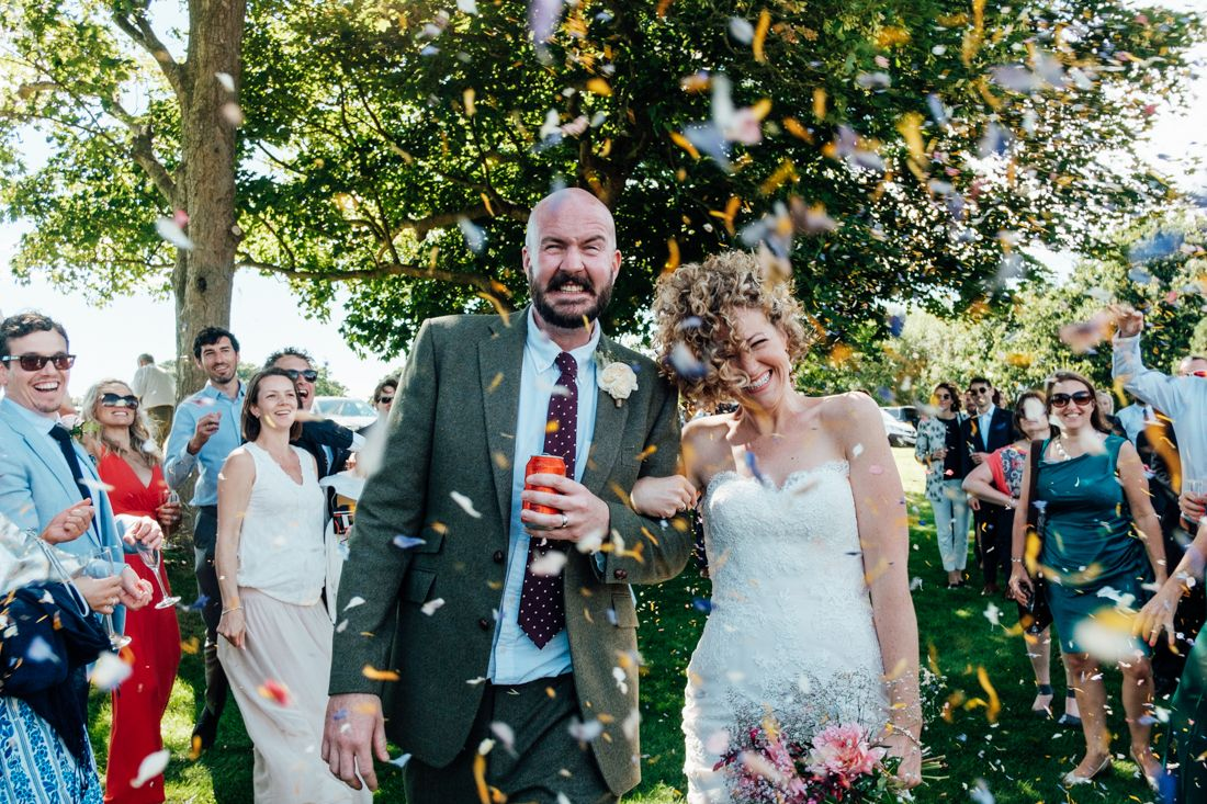 Confetti throwing at country wedding