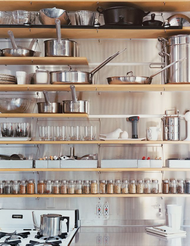 The Kitchen Shelves Are Organized With Clinical Precision Photo