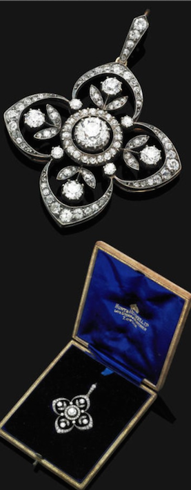 An Edwardian diamond pendant/brooch, circa 1905. Modeled as a central old brilliant-cut diamond, collet set within a diamond surround to the openwork quatrefoil diamond plaque of floral motif, suspended from a diamond-set suspension loop, with brooch fitting and fine-link neckchain, mounted in silver and gold, fitted case by Hunt & Roskell Ltd, Late Storr Mortimer, London,