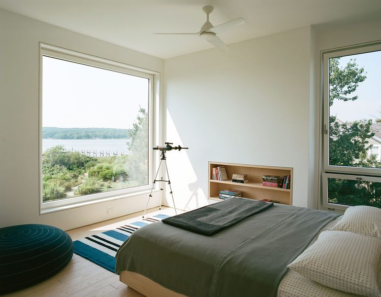 Custom ash frame window with expansive views in master bedroom of ...
