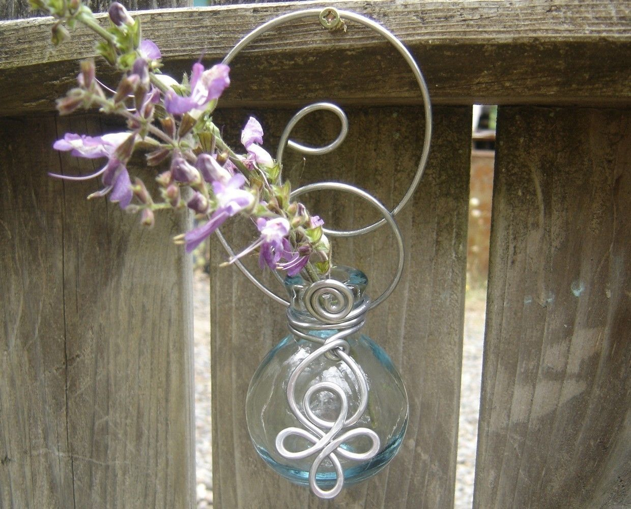 Hanging Wall Vase - Clear Round Little Celtic Spirals - for flowers,  rooting cuttings or just looking pretty-patio, sunroom, porch, kitchen. $16.00, via Etsy.