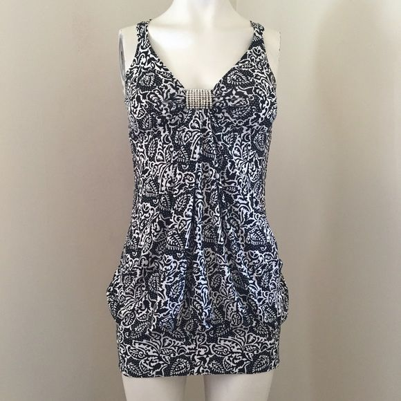 Black and white  dress Perfect for the summer - stretchy, comfy, and flattering (especially the butt). Even cute as a beach cover up to a party. Built in bra with a rhinestone accent in middle. Dresses