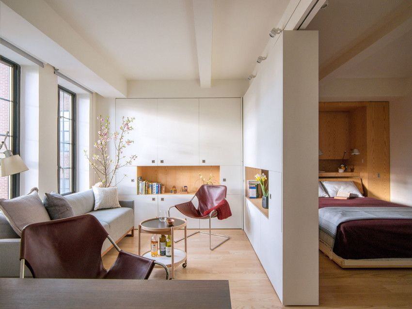Robert garneau is no stranger to ingenious small space design the nyc based architects transformer apartment with its host of custom storage solutions