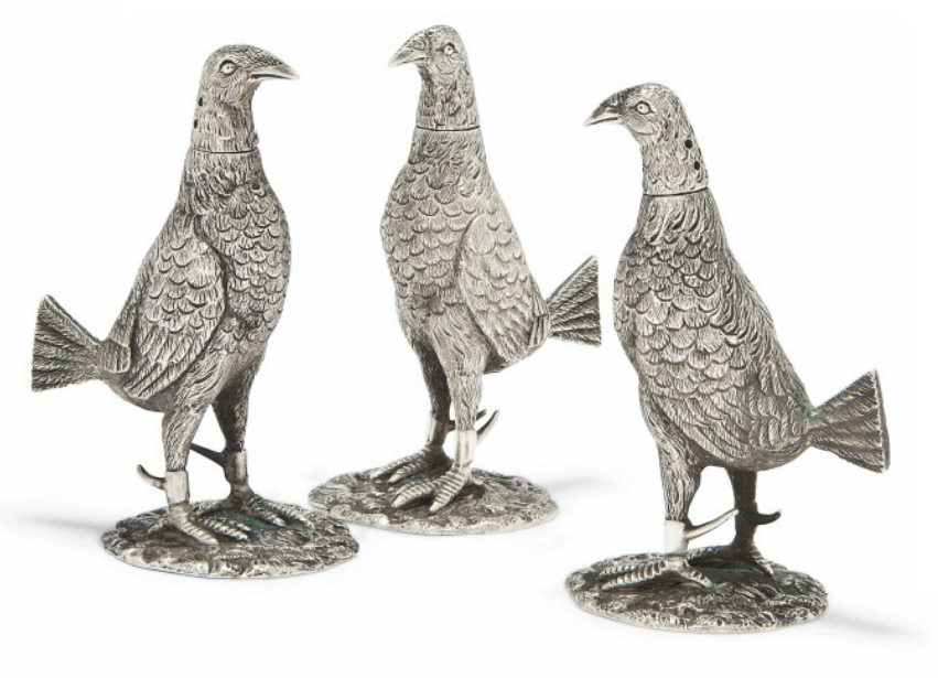 A SET OF THREE NOVELTY SILVER PEPPER POTS IN FORM OF FIGHTING COCKS MARK OF CHARLES HENRY TOWNLEY & JOHN WILLIAM THOMAS, LONDON, 1923 Each with spurs fitted to back of their feet, detachable heads 3½ in. high (9 cm.)
