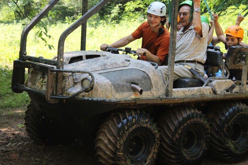 A family enjoying a ride on the Bear Crawler ATV near