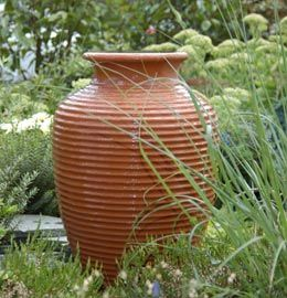 Solar Power Outdoor Water Fountains This Self Contained Water Feature Is A Terracotta Urn Water Solar Fountain Water Features In The Garden Garden Features