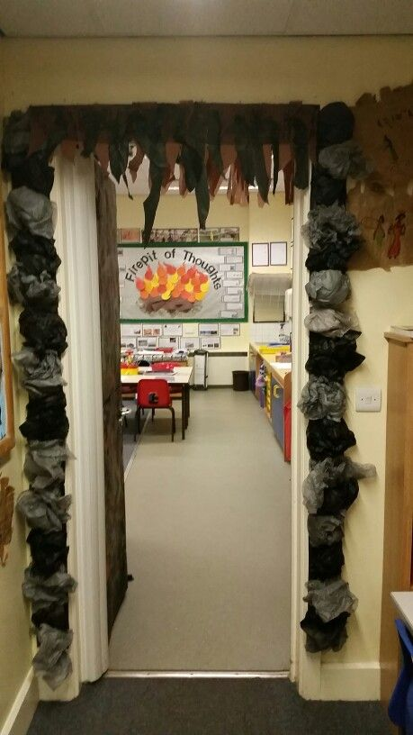 Entrance to a Stone Age classroom. Used tissue paper and crape paper for the stones and vines