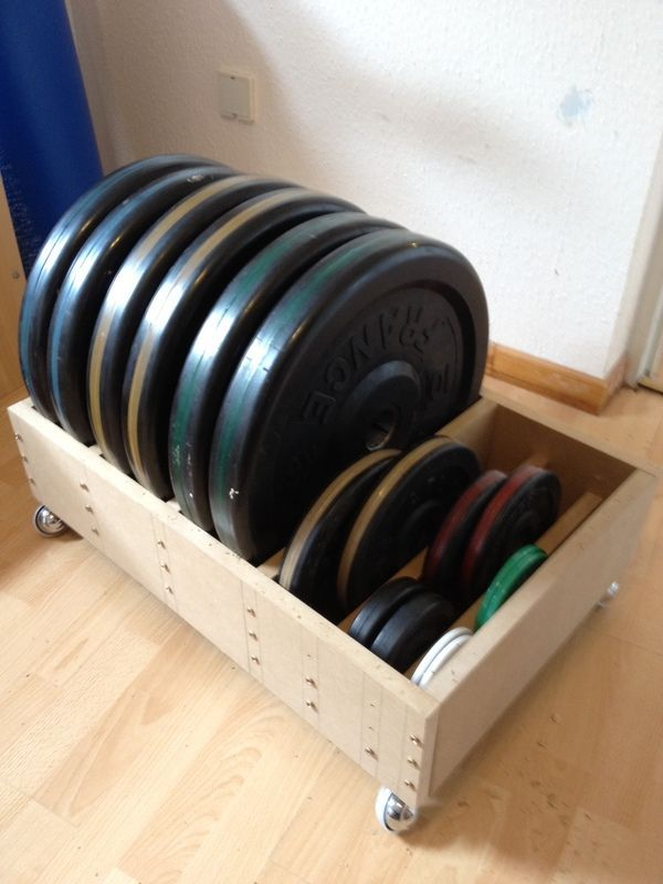 creative workout weight storage in bedroom