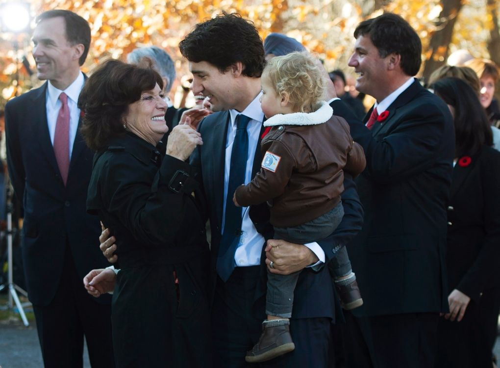 Prime minister-designate Justin Trudeau holds his son Hadrien while hugging his mother Margaret outside Rideau Hall in Ottawa on Wednesday, November 4, 2015. (Sean Kilpatrick / THE CANADIAN PRESS)