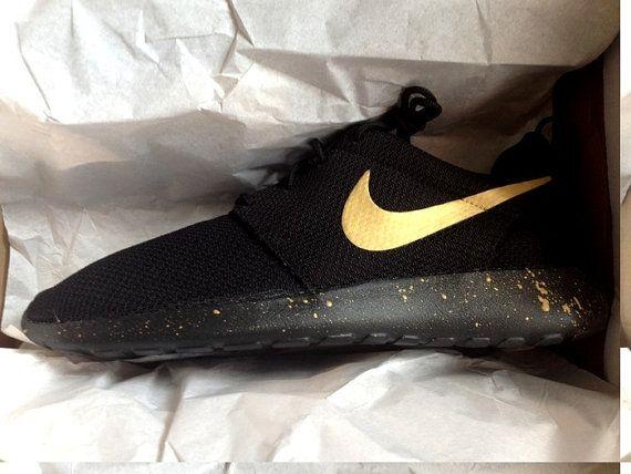 24a4bf9d78b5 Customized Nike Roshe Runs with Custom Gold Swoosh and Splatter Sole Paint  The base shoe used is the Nike Roshe Run One Black or Nike Roshe Two Black  Swoosh ...