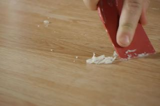 How To Clean Scented Candle Wax Off Laminate Flooring Hunker Candle Wax Removal Candle Wax Scents Spilled Candle Wax