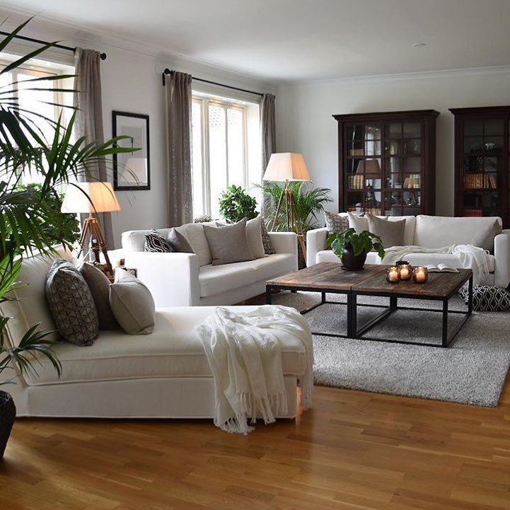 white living room decorated with green plants click here to see why you should add some green in your home