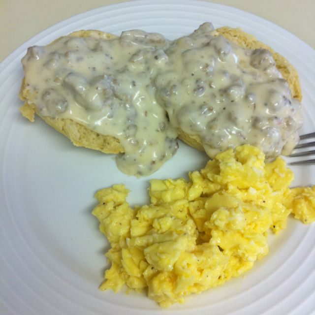 Buttermilk biscuits and sausage gravy with scrambled eggs