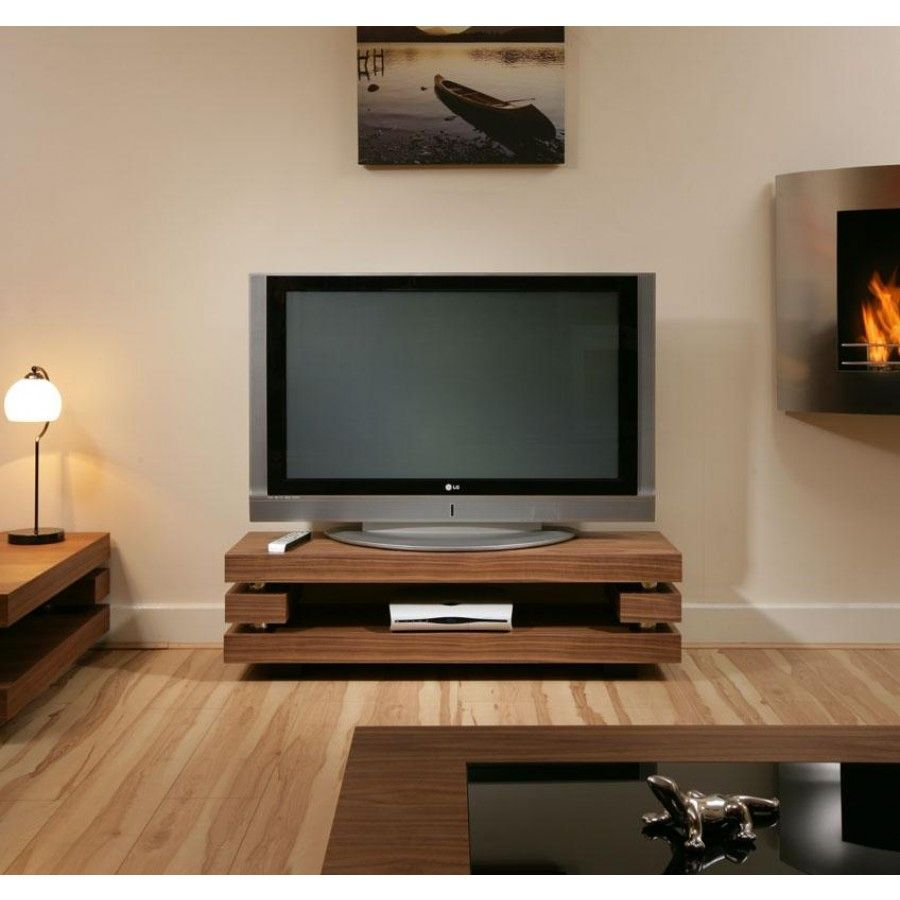 Modern designer TV cabinet/stand walnut stunning AG studios 397F. Features hidden stainless supports and beautiful walnut finish. Superb quality and strength from this German design. Call 02476 642139 or email sales@quatropi.com or visit www.quatropi.com for additional information.