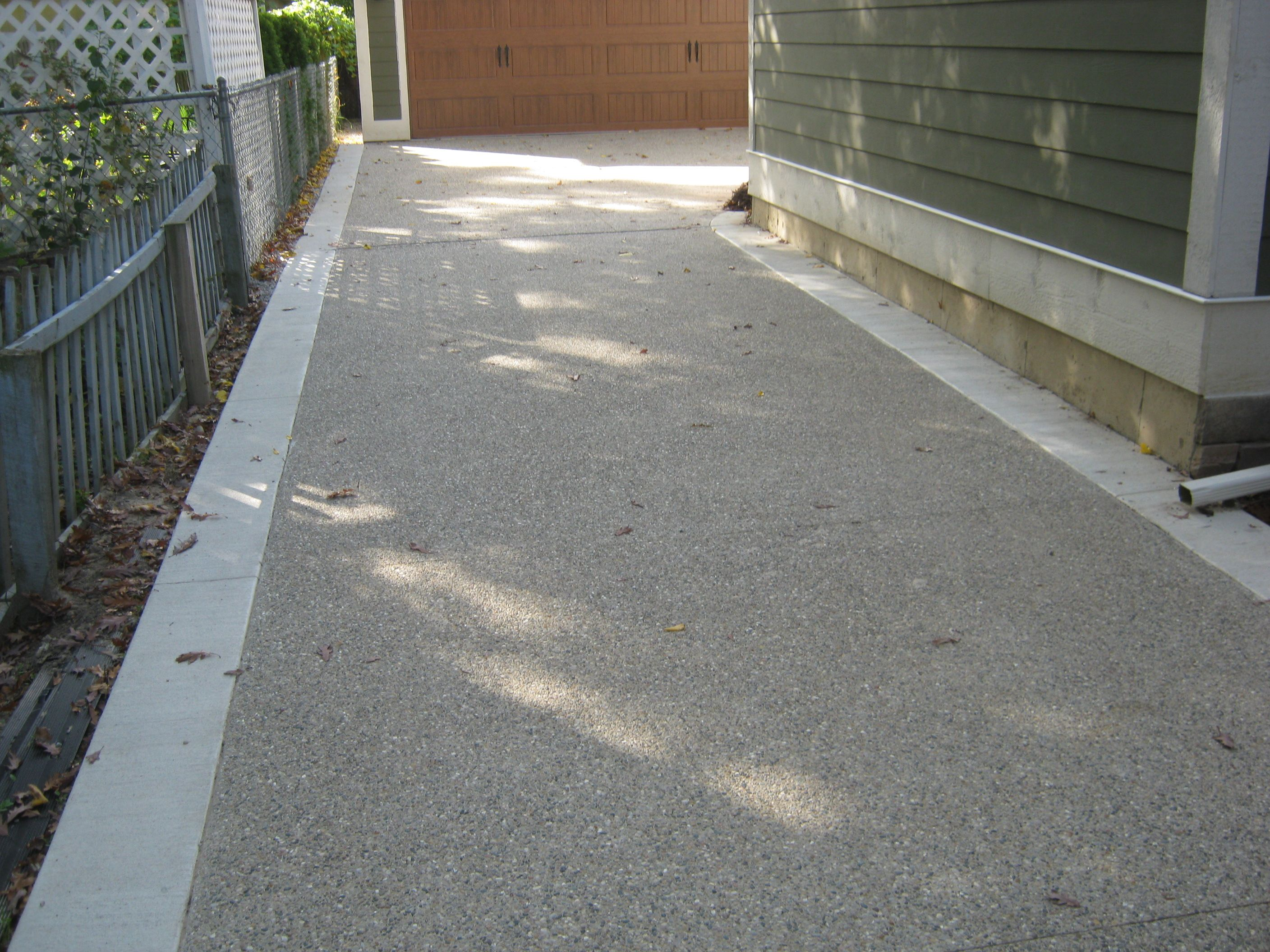 Exposed Aggregate Driveway With Regular Concrete Border Edging Asphalt Gravel