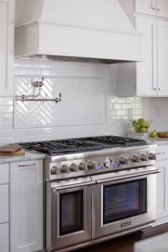Classic white kitchen design with stainless steel appliances ...