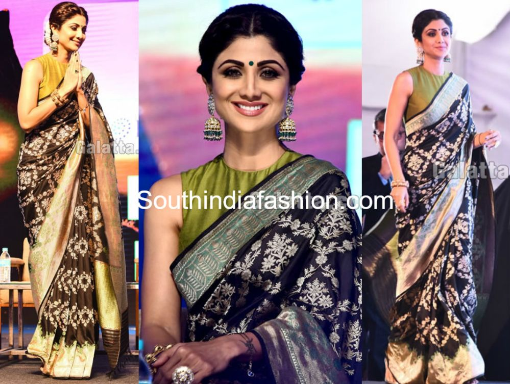 ab8abe2ae489ba Shilpa Shetty attended JITO Conference in Chennai wearing a black banarasi  silk saree paired with contrast green high neck sleeveless blouse.