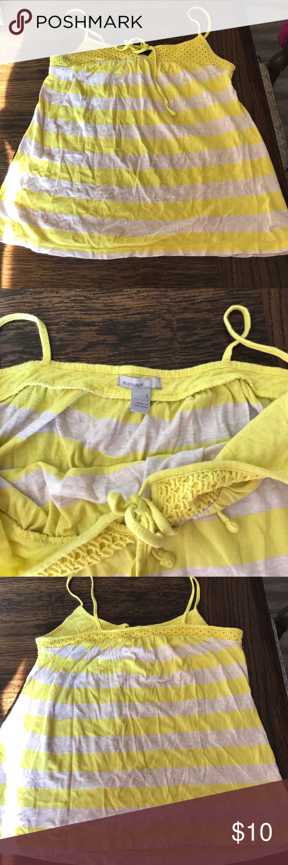 Old Navy tank top Like new worn a couple times, Old Navy yellow and cream colored tank top. Size small. Tie and ruching top. Tiny stain on back as seen on the last picture but barely noticeable.. I almost didn't see it. Old Navy Tops Tank Tops