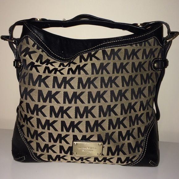 Michael Kors Signature Block MK Hobo Black/brown Medium brown/block MK block print hobo. In pretty good condition. Some scratches on name plate and slight wear on leather sides near the bottom. Michael Kors Bags Hobos