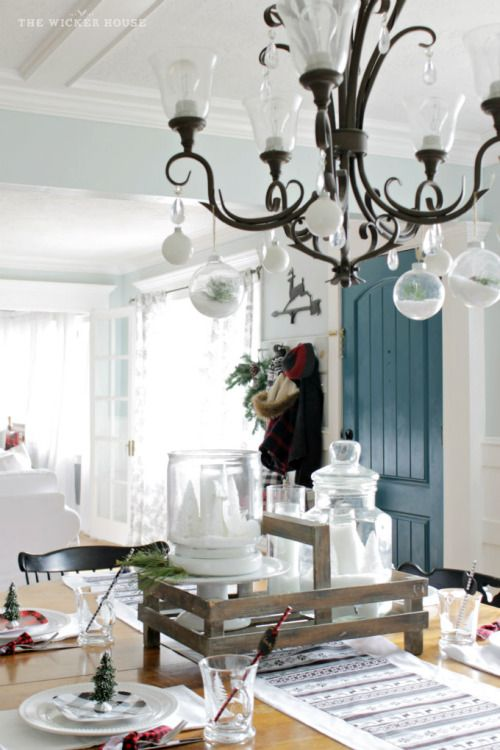 need a simple way to decorate your dining room for the christmas season try hanging baubles or other ornaments from your chandelier instant holiday feel - Simple Ways To Decorate Your House For Christmas