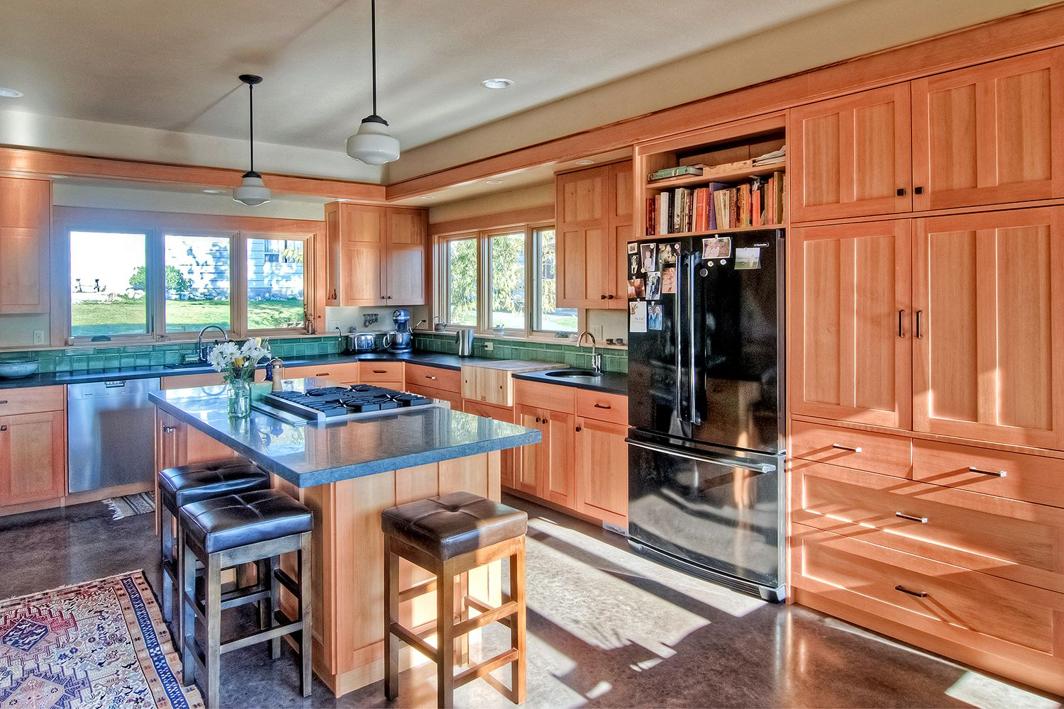 Custom Maple Kitchen Cabinets With Kitchen Island Stove And Stained Concrete Floors Millworks Is Craftsman Kitchen Modern Kitchen Design Maple Kitchen Cabinets