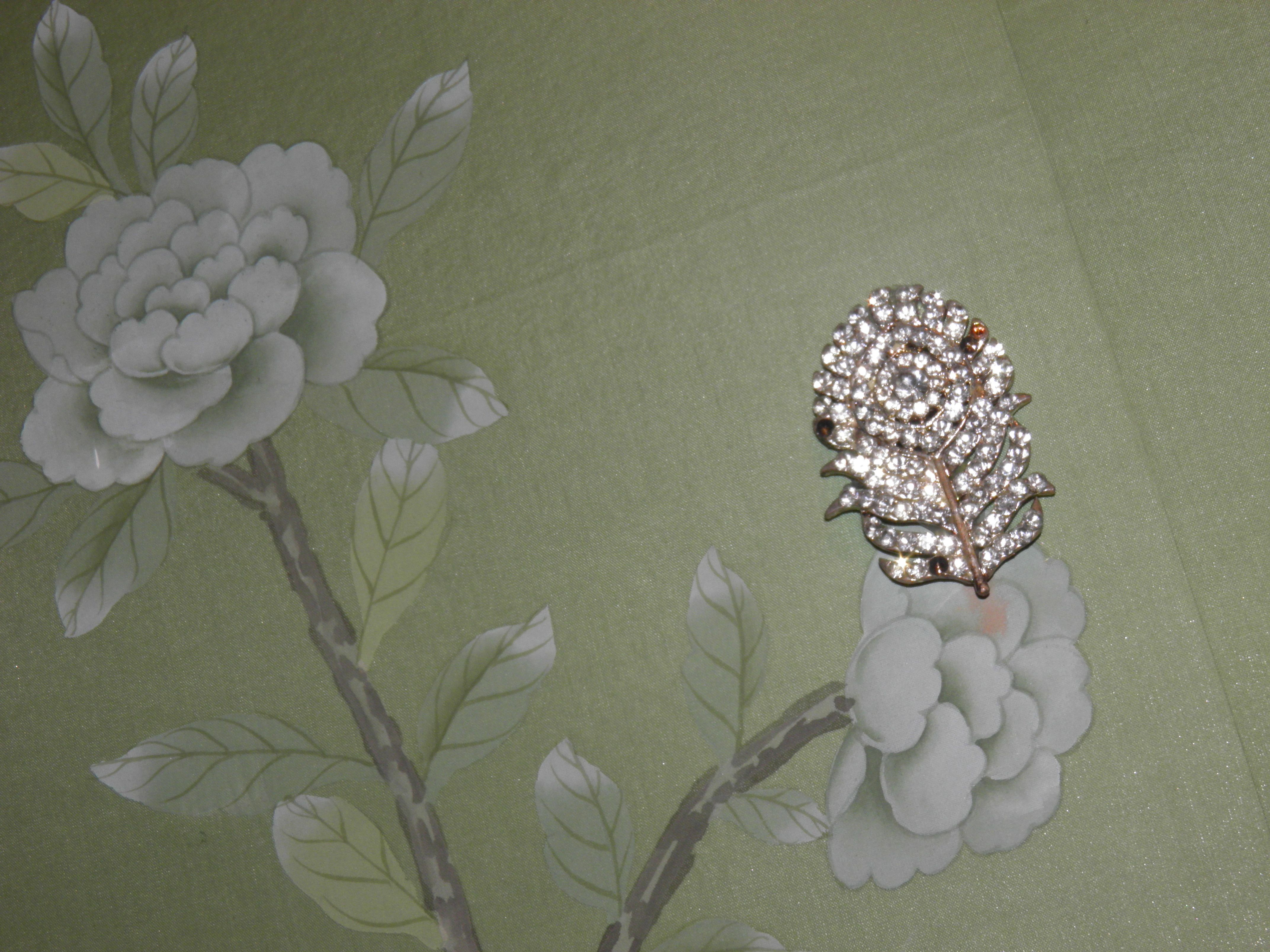 Mint green  vintage jewel embelished wallpaper at the Matthew Williamson Boutique.