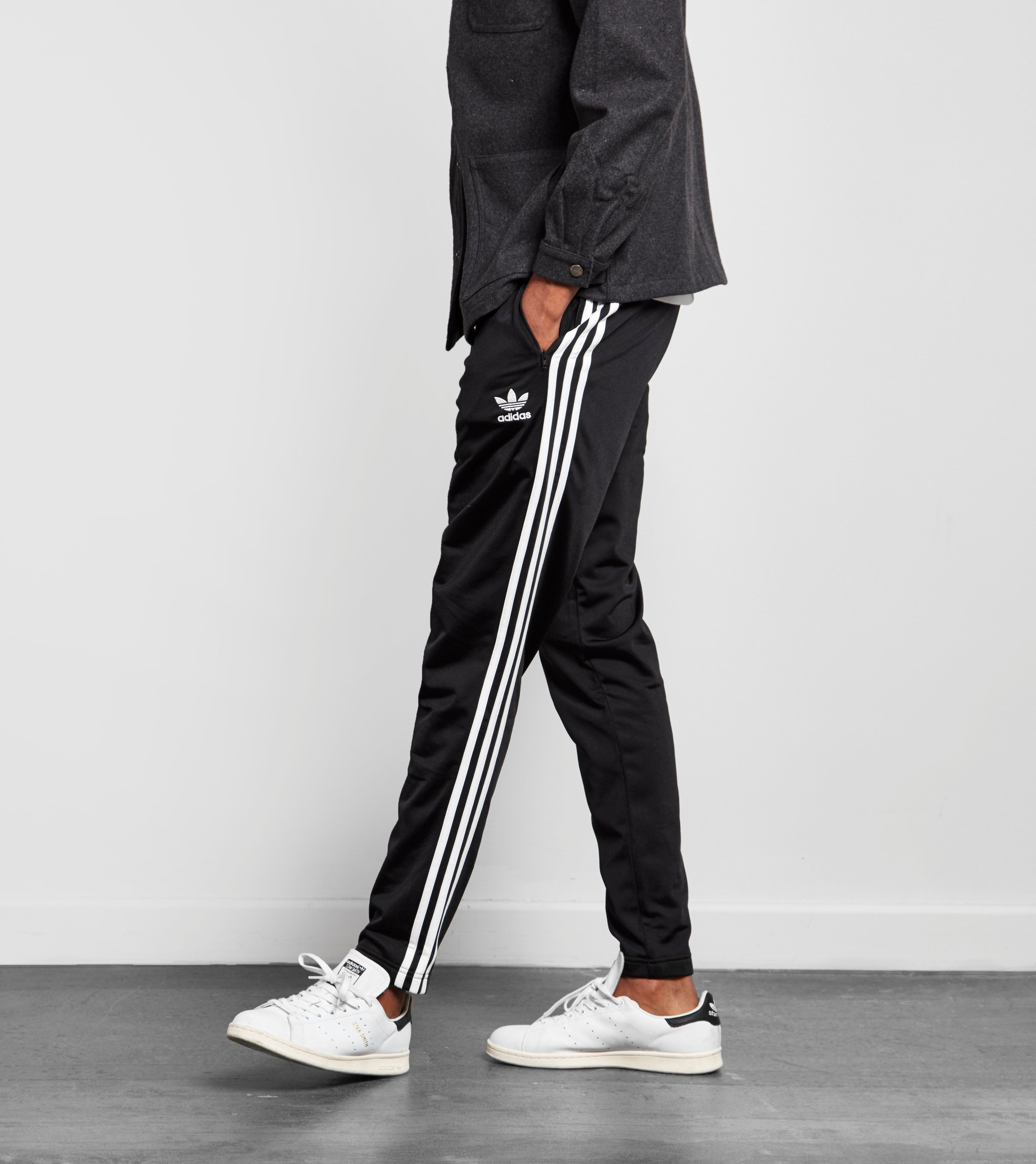 buy popular 8d696 90b0c adidas Originals Superstar Taper Track Pants - find out more on our site.  Find the freshest in trainers and clothing online now.