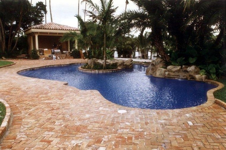 Custom Pool Ideas beach entry pools design and music features for your custom swimming pool Blue Pool
