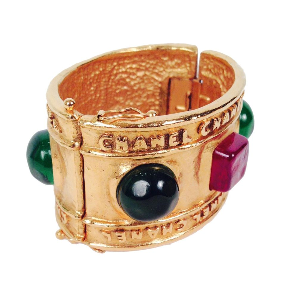 1986 Vintage Chanel Gripoix Hinged Bracelet With Poured Glass Stones   From a unique collection of vintage cuff bracelets at https://www.1stdibs.com/jewelry/bracelets/cuff-bracelets/